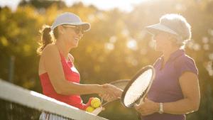 Women shaking hands after tennis