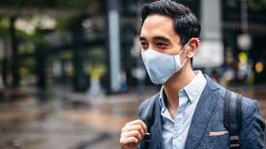 Deaf man wearing face mask