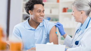 Man getting flu shot from doctor